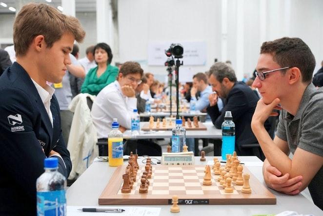 Carlsen and Caruana at chess board.