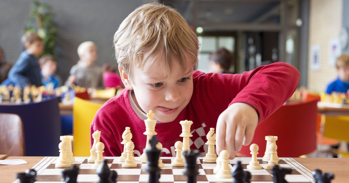 Little Boy Making a Chess Move