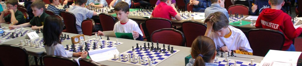 Kids playing chess at tournament.