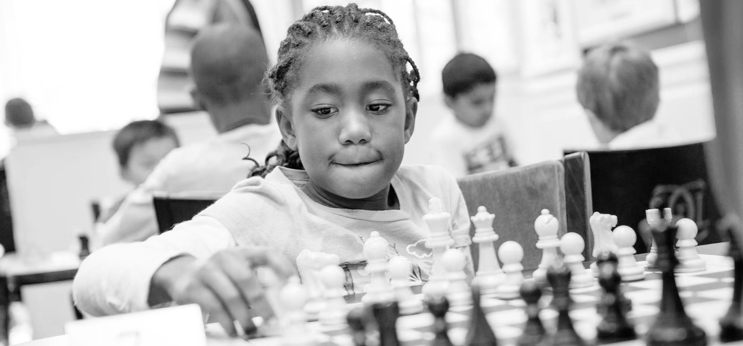 Black girl playing chess full size Cropped