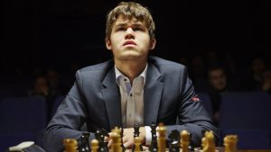 Magnus Carlsen contemplating chess position.