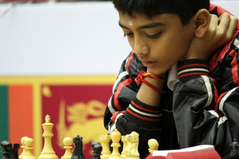D. Gukesh studying chessboard