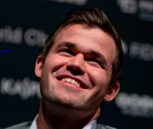 Norway's Magnus Carlsen, World Chess Champion and #1 rated player in the world at 2835, smiles after defending title.