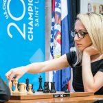 Nazi Paikidze moving chess pieces