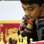 D. Gukesh studying chessboard